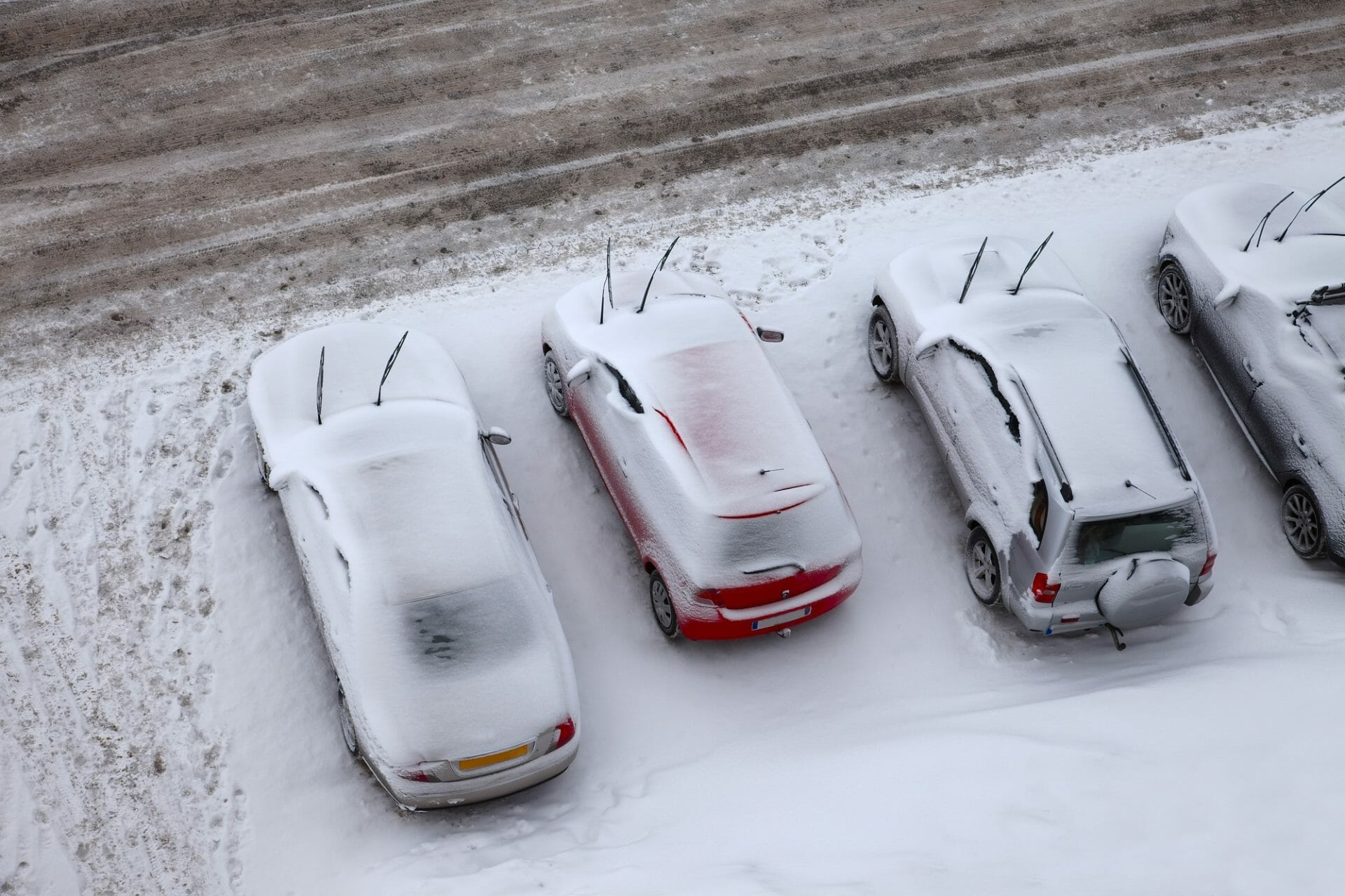Parking Lot and cars covered in snow and ice